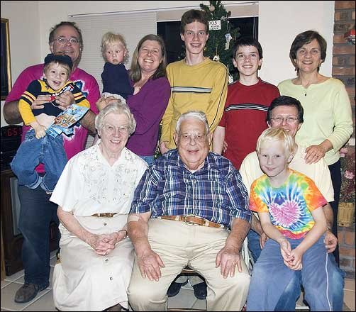 Ken Hopper KD7KH on his 80th birthday with wife Barbara and family members. Son-in-law Harold Davis took this copyrighted photo. He is shown in the back row with his wife Phyllis and their children Julian, Nicky and Matthew. Also pictured are Phyllis' brother Chris' family: Chris, Dejonghe, David and Steven.